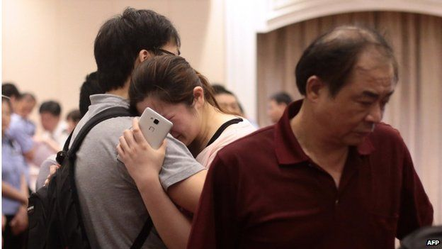 "Relatives of passengers on board the Dongfangzhixing or ""Eastern Star"" which sank en route from the eastern city of Nanjing to the southwestern city of Chongqing, react as they wait for information at a hotel in Nanjing, east China""s Jiangsu province on 2 June 2015"