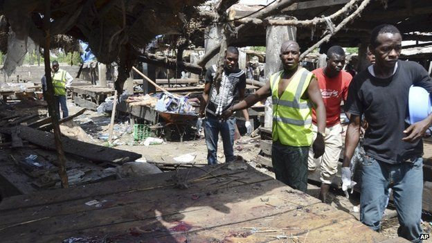 Rescue workers at the site of a bomb attack at a market in Maiduguri , Nigeria, 2 June 2015