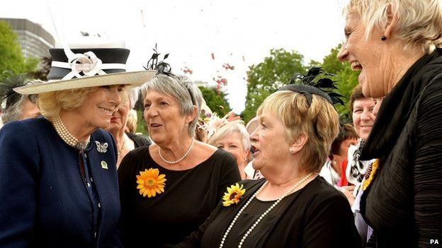The Duchess of Cornwall talks with the Calendar Girls (left to right) Angela Knowles, Ros Fawcett and Patricia Stewart