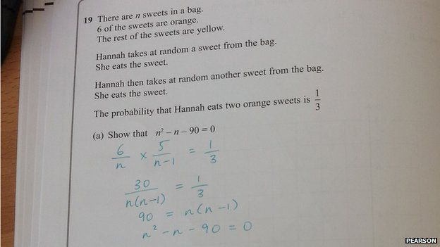 A GCSE maths paper - with answer written beneath question