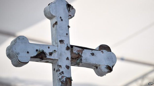 A bullet-scared cross on display at the Sarajevo stadium where the Pope celebrated Mass, 6 June 2015