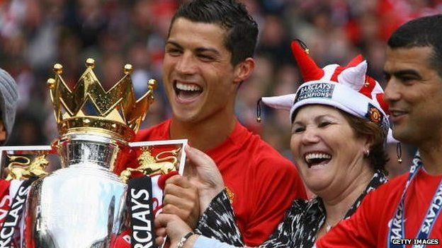 Cristiano Ronaldo of Manchester United celebrates winning the Barclays Premier League trophy with his mother in May 2009