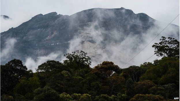 Malaysia's Mount Kinabalu is seen among mists from the Timpohon gate check point a day after the earthquake in Kundasang, a town in the district of Ranau on 6 June 2015