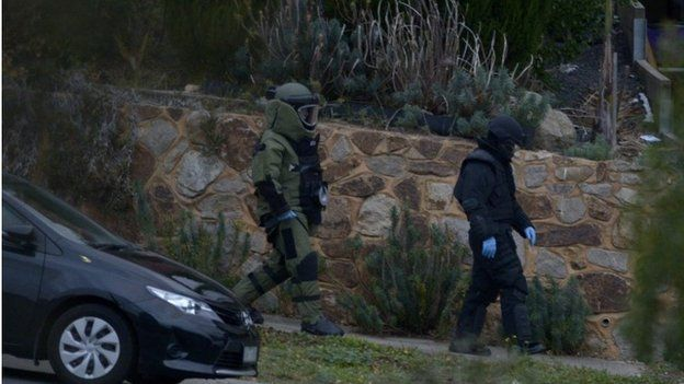 Officers wearing bomb suits raid a home in Greenvale, Melbourne, Australia, 08 May 2015.