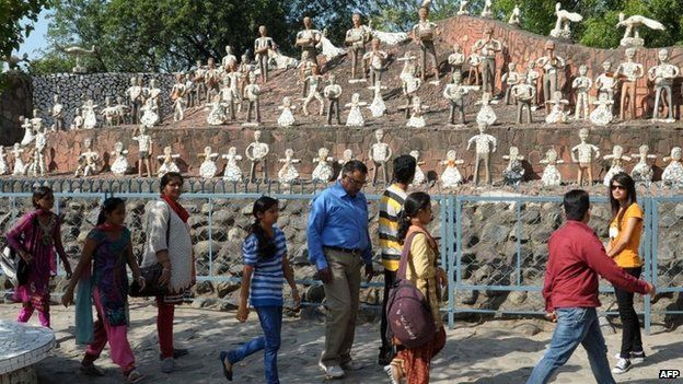 This photo taken on October 31, 2014 shows Indian visitors in the Rock Garden, built by self-taught Indian artist Nek Chand Saini over the course of 18 years, in Chandigarh.