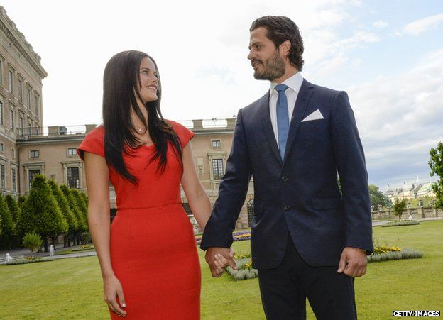 Swedish Prince Carl Philip poses with former model Sofia Hellqvist in the garden of the Stockholm Palace, on 27 June 2014 during a press statement to announce their engagement.