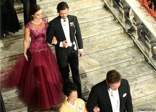 Prince Carl Philip of Sweden (right) and his fiancee Sofia Hellqvist arrive at the Nobel banquet at the Stockholm City Hall on 10 December 2014.