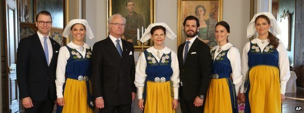 The Swedish Royal family, from left Prince Daniel, Crown Princess Victoria, King Carl Gustaf, Queen Silvia, Prince Carl Philip, his fiancee Sofia Hellqvist and Princess Madeleine pose for a photograph during a reception at the Royal Palace during the National Day of Sweden celebrations in Stockholm Saturday, June 6, 2015