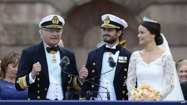 Sweden's King Carl XVI Gustaf (left) delivers a speech after the wedding of Princess Sofia (right) to Prince Carl Philip (centre) at Stockholm Palace (13 June 2015)
