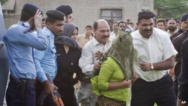 """Rimsha"" is escorted to a helicopter after being released form jail in Rawalpindi, Pakistan, 8 September 2012"