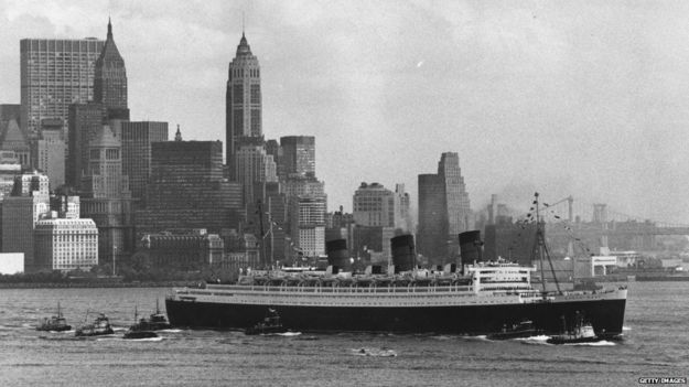 The Queen Mary steams out of New York. The Queen Mary and her sister ship the Queen Elizabeth provided a twice weekly transatlantic service for Cunard between the 1940s and 1960s