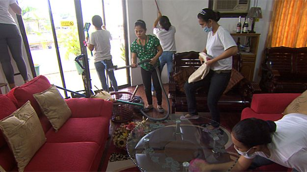 Trainee maids learning to clean