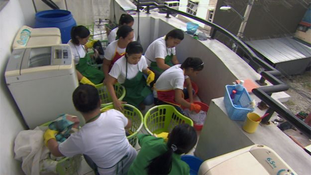 Trainee maids washing clothes