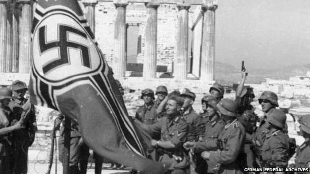 German soldiers raising the German war flag over the Acropolis