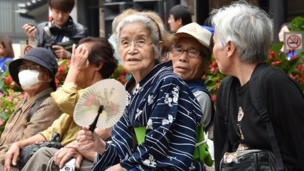 Elderly residents rest in the grounds of a temple in Tokyo on September 15, 2014 as the country marks Respect-for-the-Aged-Day.