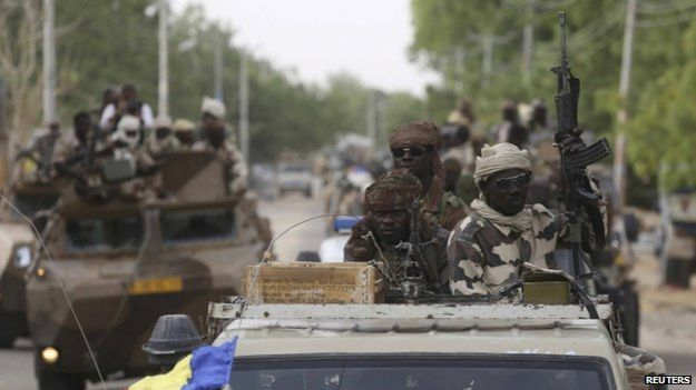 Chadian soldiers drive in the recently retaken town of Damasak, Nigeria, 18 March 2015