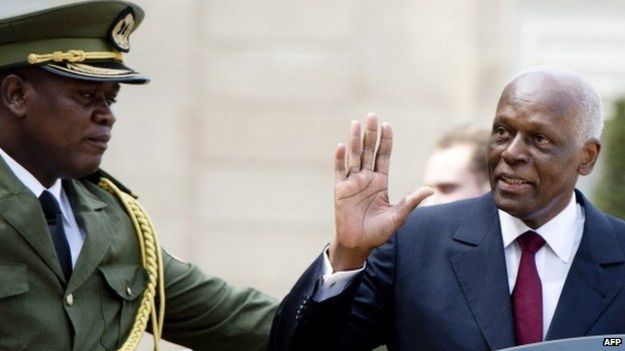 Angola's President Jose Eduardo Dos Santos (R) waves as he leaves the Elysee presidential palace on 29 April 2014, in Paris after a meeting with French president