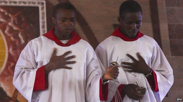 Nigerians attend Palm Sunday service and pray for peace around the outcome of presidential elections at a church service in the oil rich Niger Delta
