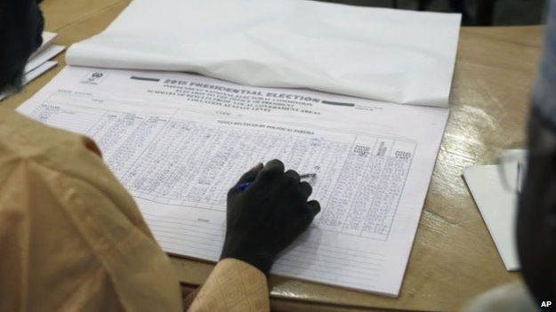 A Nigerian election official reads local results in Kaduna, Nigeria on 30 March, 2015