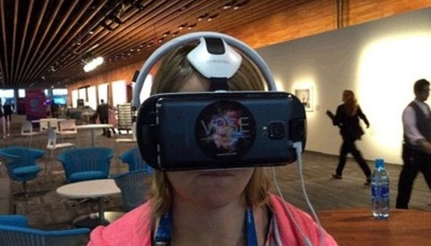 Me wearing VR headset at Ted conference