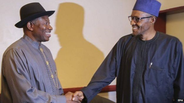 File photo: Goodluck Jonathan (left) and Muhammadu Buhari shake hands after signing a peace deal agreeing to respect the outcome of the polls