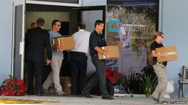 Law enforcement agents raid the office of Dr Salomon Melgen in West Palm Beach, Florida on 30 January 2013