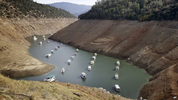 In this Thursday, October 30, 2014, file photo, houseboats float in the drought-lowered waters of Oroville Lake near Oroville, California
