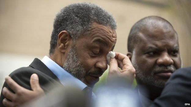 Anthony Ray Hinton wipes tears from his eyes after being released