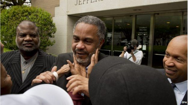 Anthony Ray Hinton is greeted by friends and family outside the Jefferson County Jail