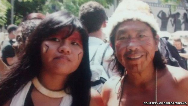 Carlos Tukano and his daughter in an undated photo