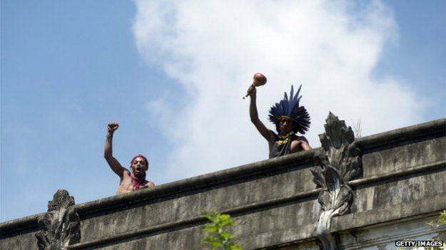 Two men protest against their eviction by the police from the former Indigenous Museum, next to the Maracana stadium, in Rio de Janeiro, Brazil on March 22, 2013.