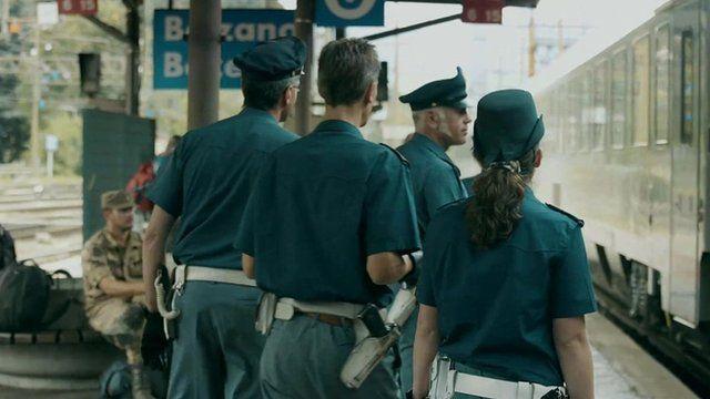 Police on a station platform
