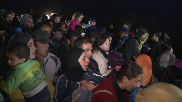 Refugees and migrants who have broken through the police line