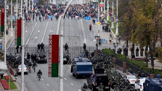 Belarusian police block a road against protesters during a rally against President Lukashenko in Minsk, Belarus, 25 October 2020
