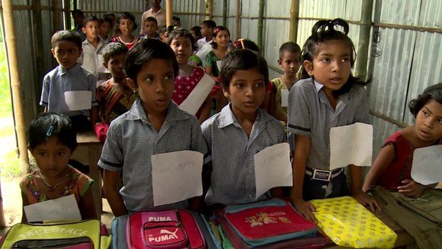 Children wearing sign saying New Indian