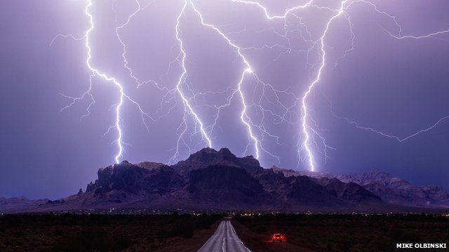 Multiple lightning strikes over a mountain