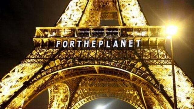 Eiffel Tower with sign reading FOR THE PLANET