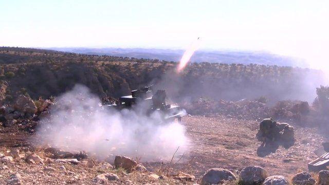 Kurdish forces firing rockets towards Sinjar