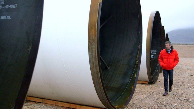 Spencer Kelly stands next to Hyperloop tubes