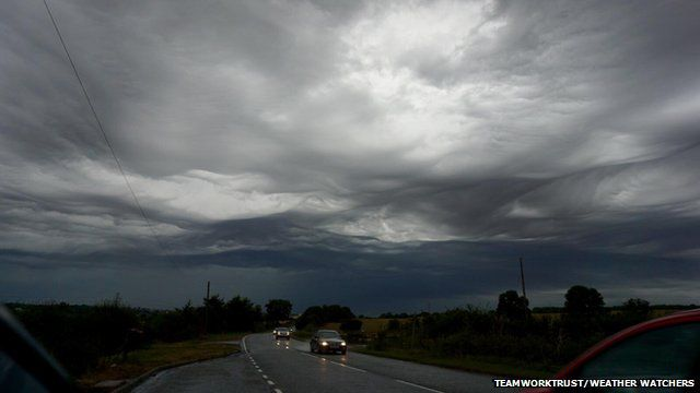 Wave like clouds over a motorway
