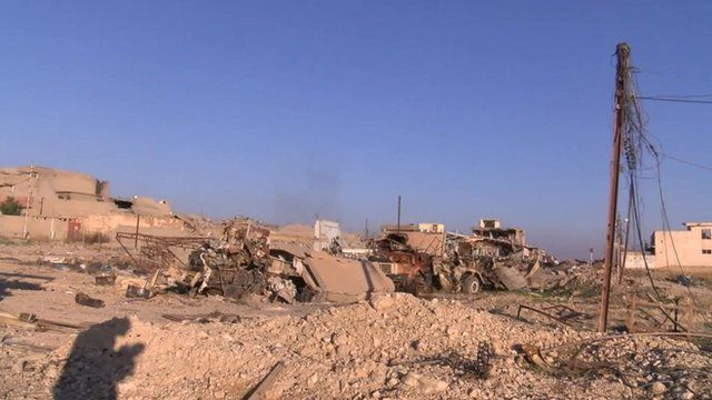 Rubble and damaged buildings and vehicles