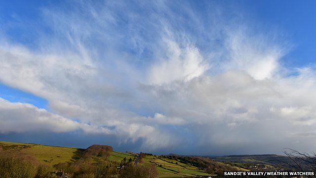 Storm cloud over country landscape