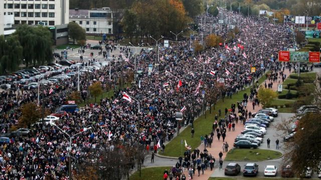People attend an opposition rally to reject the Belarusian presidential election results in Minsk, Belarus, 25 October 2020
