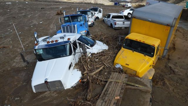 Vehicles trapped by a mudslide on California Highway 58 in Mojave, California