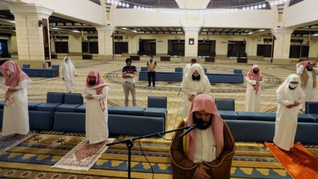 Muslims pray at a mosque in Saudi Arabia