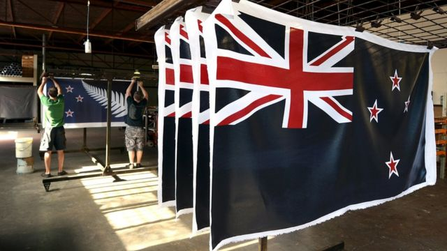 Factory workers Garth Price and Andrew Smith hang new designs of the national flag of New Zealand at a factory in Auckland, New Zealand. 24 November 2015.