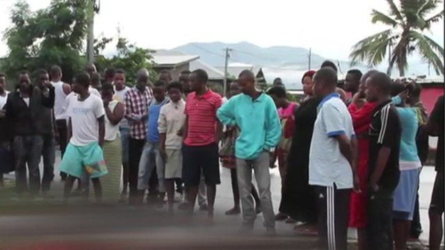 Burundian villagers gathered in mourning