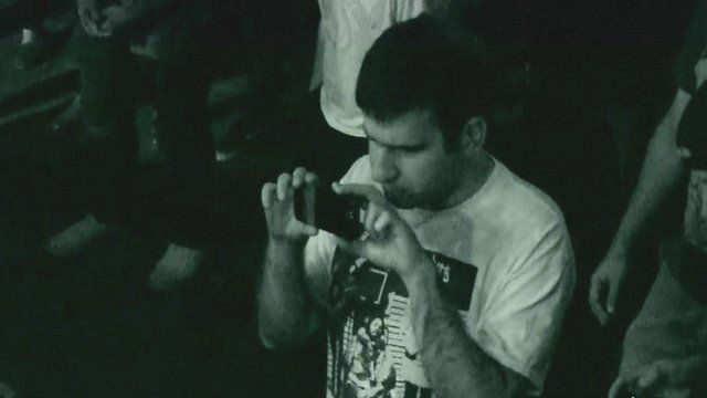 Ahmad Zaghal taking pictures at a concert