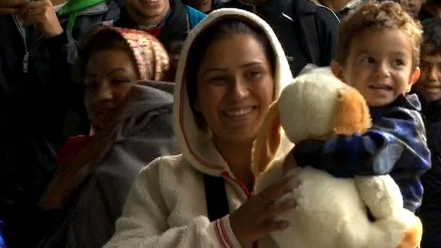 Woman and child carrying soft toy