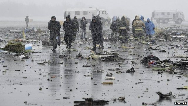 """Members of Russia""""s Emergencies Ministry and other services work at the crash site"""